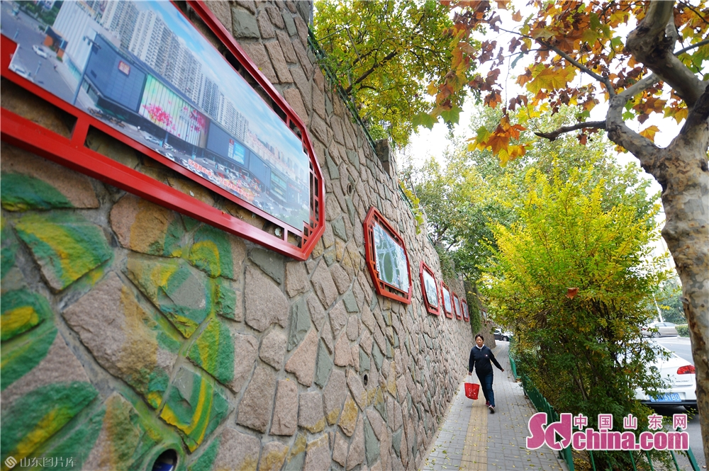 A passenger walks in Liaoyuan Road of Shibei District in Qingdao, east China&amp;rsquo;s Shandong Province on November 5, 2018. A landscaping action kicked off here on Monday.<br/>