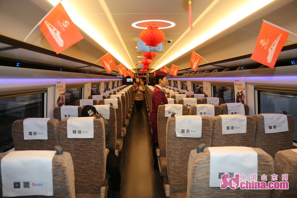 Passengers get on the bullet train in Jinandong Railway Station in Jinan, east China&amp;rsquo;s Shandong Province on December 26, 2018. Jinan-Qingdao High-speed Railway opens today, cutting down the running time of the fastest train from Jinan to Qingdao to 1 hour and 40 minutes.<br/>