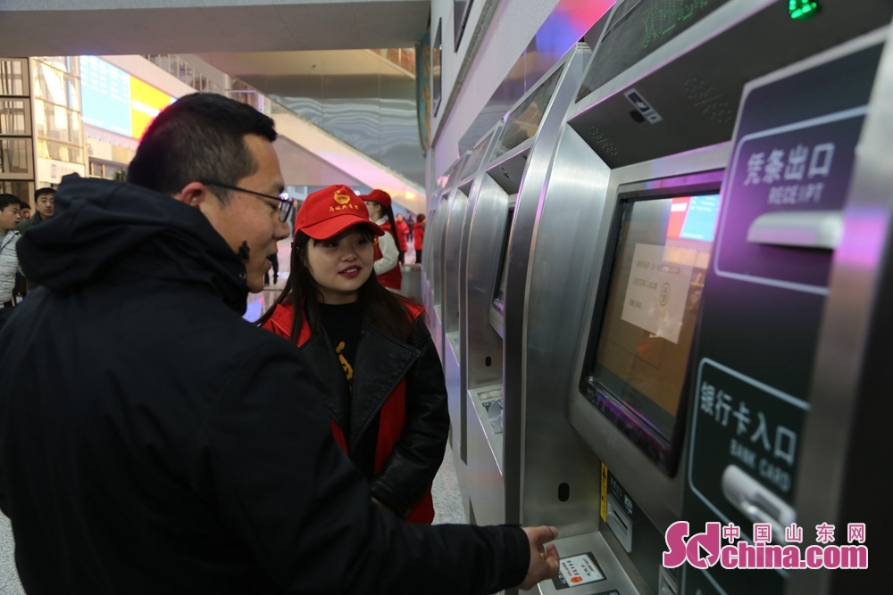 A passenger buys ticket in Jinandong Railway Station in Jinan, east China&amp;rsquo;s Shandong Province on December 26, 2018. Jinan-Qingdao High-speed Railway opens today, cutting down the running time of the fastest train from Jinan to Qingdao to 1 hour and 40 minutes.<br/>