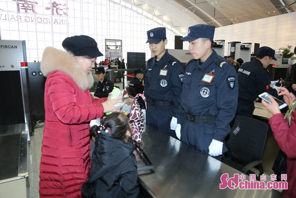 Passengers accept security check in Jinandong Railway Station in Jinan, east China&amp;rsquo;s Shandong Province on December 26, 2018. Jinan-Qingdao High-speed Railway opens today, cutting down the running time of the fastest train from Jinan to Qingdao to 1 hour and 40 minutes.<br/>