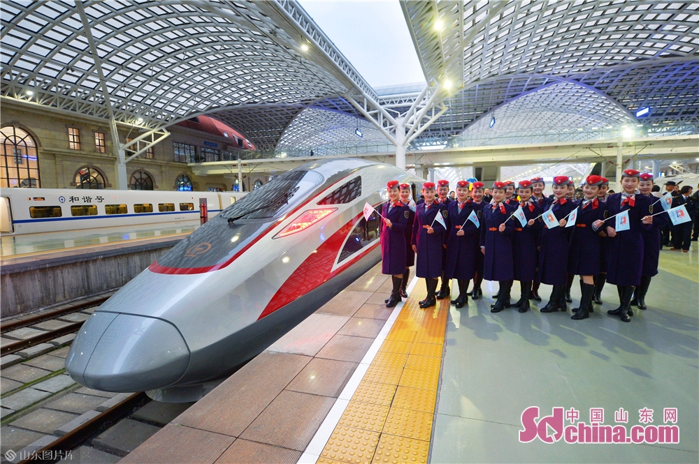 Train attendants of the Haizhiqing Qingdao railway section celebrate the launching of the Fuxing bullet train on December 5, 2018.<br/>