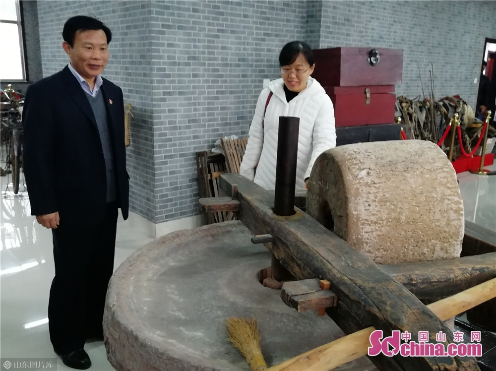 Visitors view the millstone in a village history museum on December 6, 2018 in Weifang National Hi-tech Industrial Development Zone in Weifang, Shandong Province. Weifang National Hi-tech Industrial Development Zone has been committed to the construction of county sage museums, village history museums and cultural centers, so as to retain homesickness, record the history and inherit the historical civilization for the masses, and enrich their cultural life.