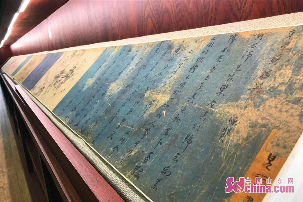 A picture scroll is seen in the exhibition in Jinan, east China's Shandong Provicne. Shandong Precious Ancient Books Exhibition kicked off in Shandong Library on June 9 and will last to June 29, 2018. (Sdchina.com/Ma wenwen)