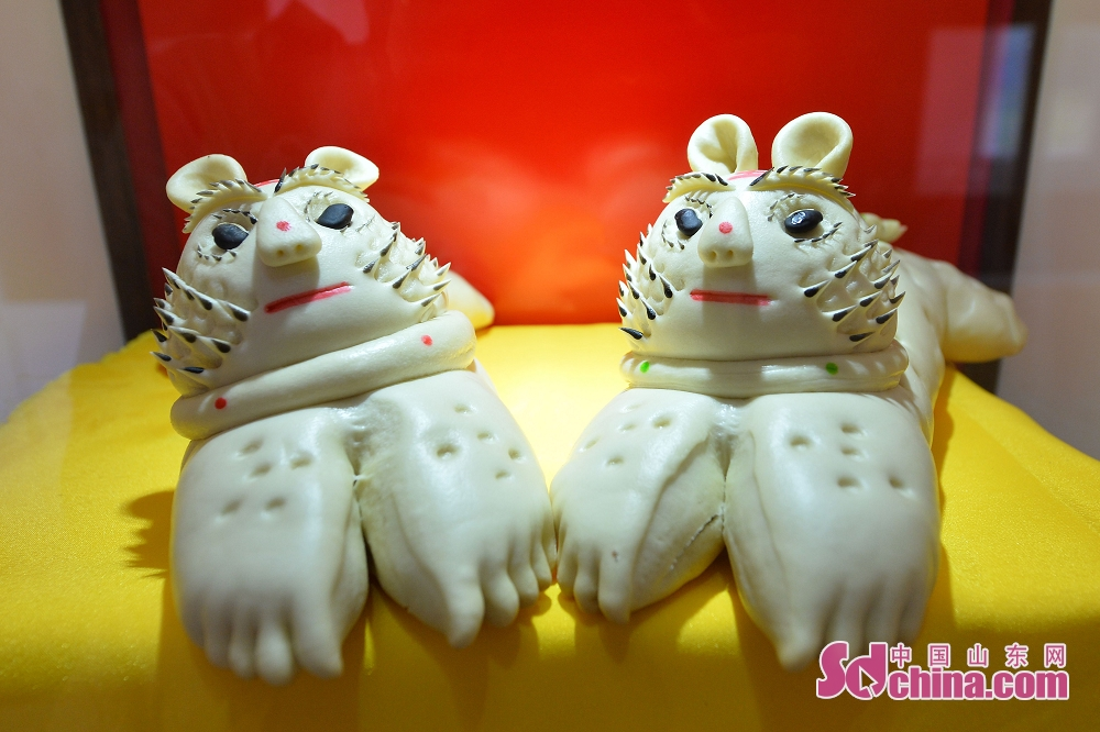 Photo taken on June 30 shows tiger-patterned steamed buns in Qingdao, a coastal city of Shandong Province. 2018 Laoshan Wanggezhuang Steamed Bun Culture Festival and 10th Patterned Steamed Bun Contest was held here on June 30, 2018.<br/>