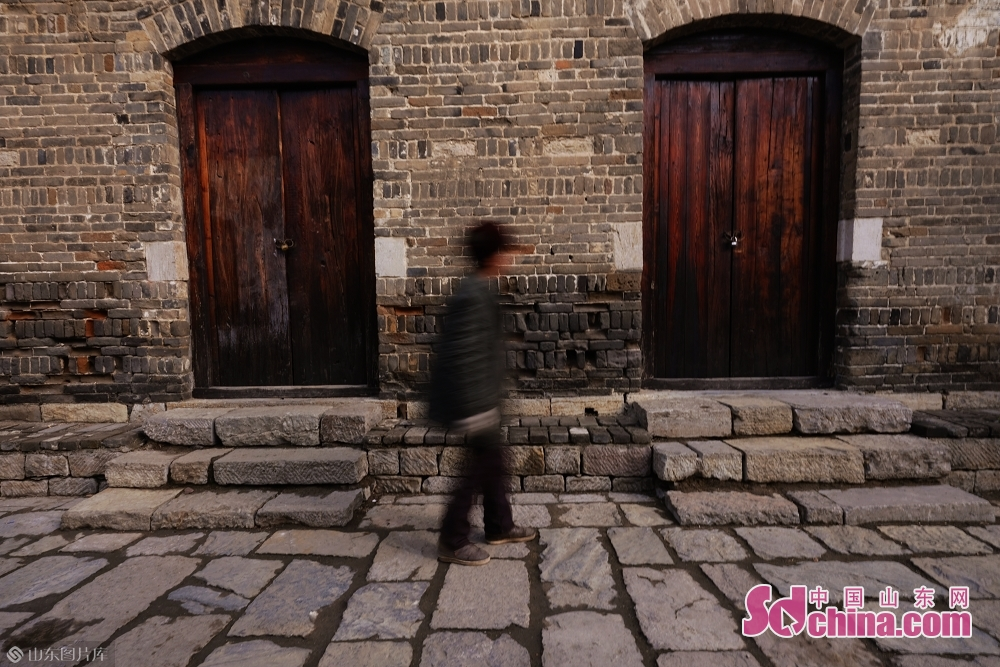 A tourist walks in the ancient town of Taierzhuang in Zaozhuang, east China&amp;rsquo;s Shandong Province, on January 15, 2019.<br/>