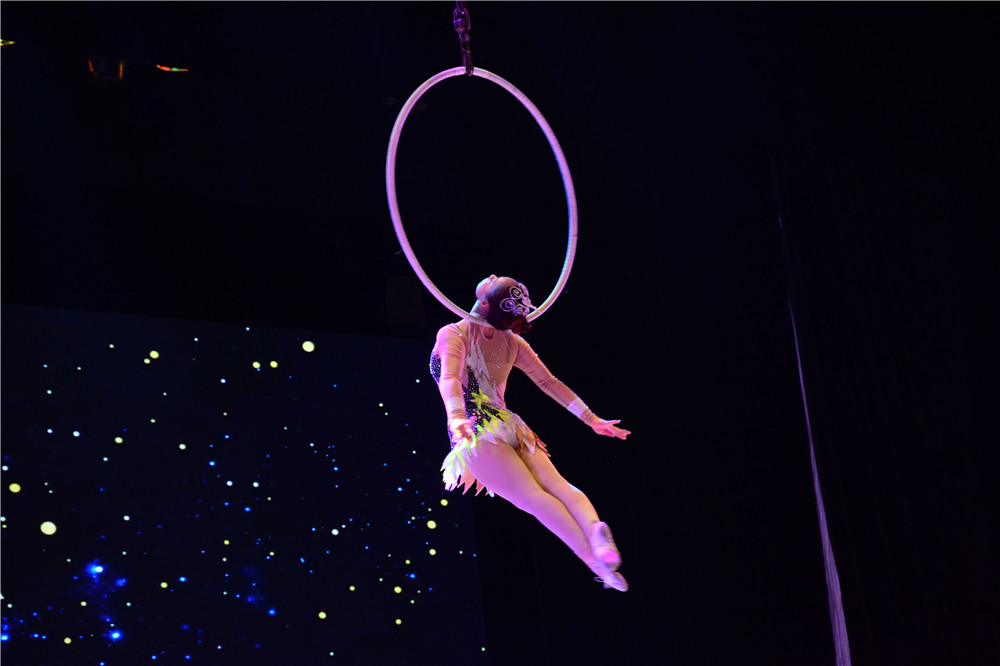 "A acrobat performs during an exquisite acrobatics show of New Year Party recently in Jinan, capital of Shandong Province. The acrobats in Shandong have been committed to ""translate"" China and spread Chinese culture to the world through acrobatics, a shared cultural heritage of mankind."