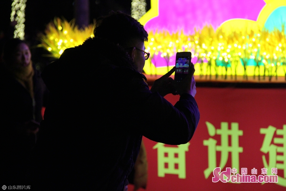 Visitors view lanterns during a lantern fair in the forest park in Jining, east China's Shandong Province.<br/>