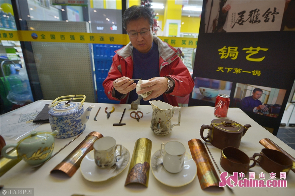 A craftsman repairs broken porcelain in Xizhen Museum of Qingdao, east China&amp;rsquo;s Shandong Province on January 28, 2019. The Intangible Cultural Heritage Exhibition kicked off here on Monday to greet the Chinese Lunar New Year, which falls on Feb. 5 this year.<br/>