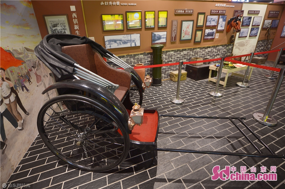 A rickshaw is seen in Xizhen Museum of Qingdao, east China&amp;rsquo;s Shandong Province on January 28, 2019. The Intangible Cultural Heritage Exhibition kicked off here on Monday to greet the Chinese Lunar New Year, which falls on Feb. 5 this year.<br/>