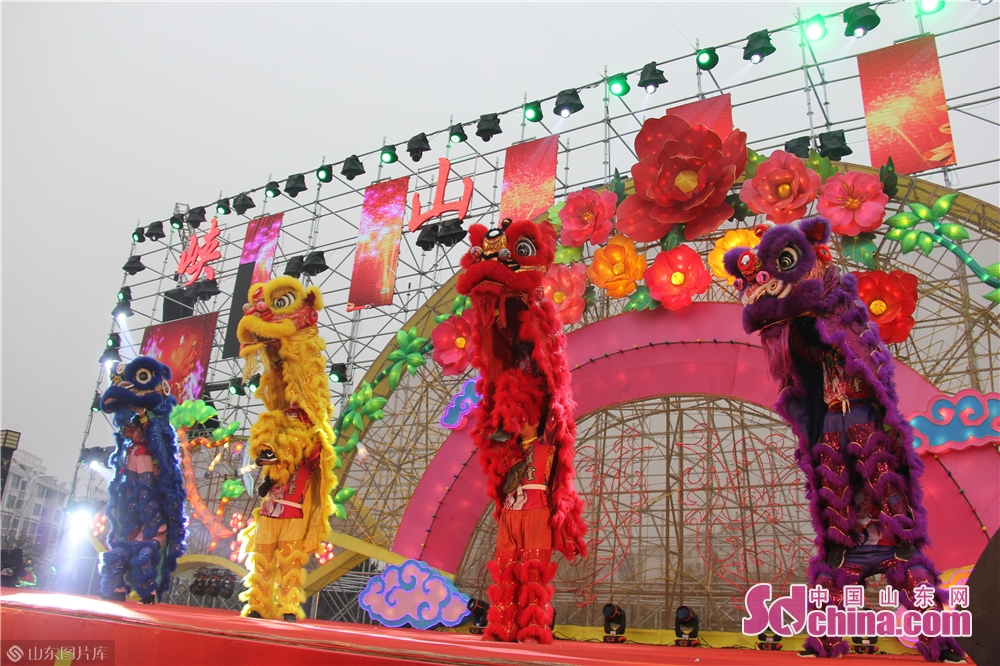 Folk artists perform lion dance during a lantern festival on January 30, 2019 in Xiashan District of Weifang, east China's Shandong Provicne. The 4th Xiashan Spring Lantern Festival and the 3rd Xiashan Food Festival kicked off here on Wednesday to welcome the upcoming Chinese Lunar New Year, which falls on Feb. 5 this year.