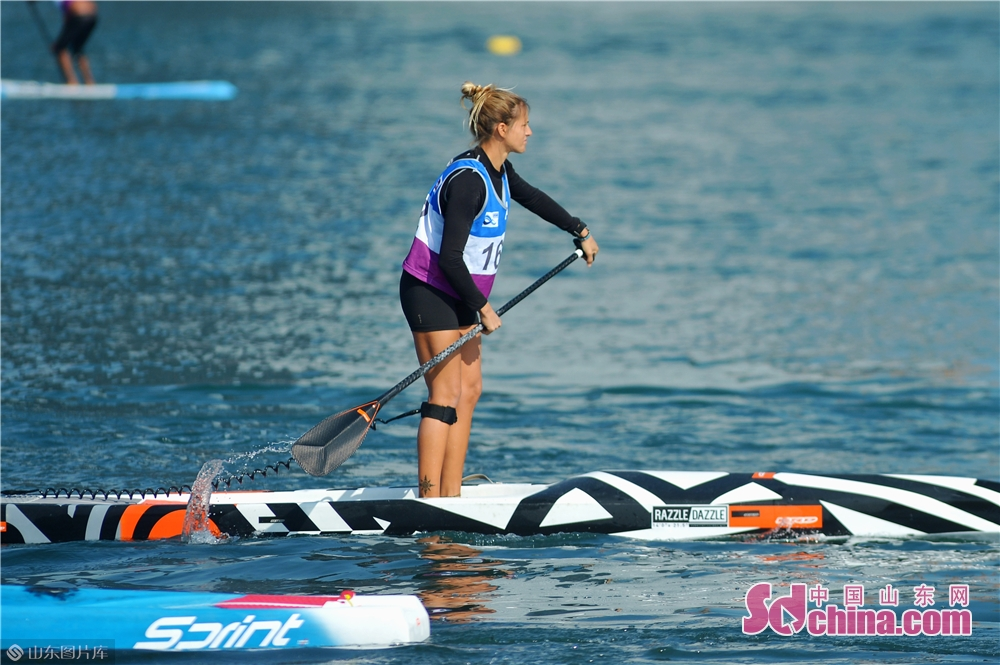 A paddleboard athlete races on the sea during the COYC Cup ICF Standup Paddling World Championships in Qingdao, east China's Shandong Province on Oct. 27, 2019. The event held on last Sunday attracted more than athletes from over 40 countries and regions.