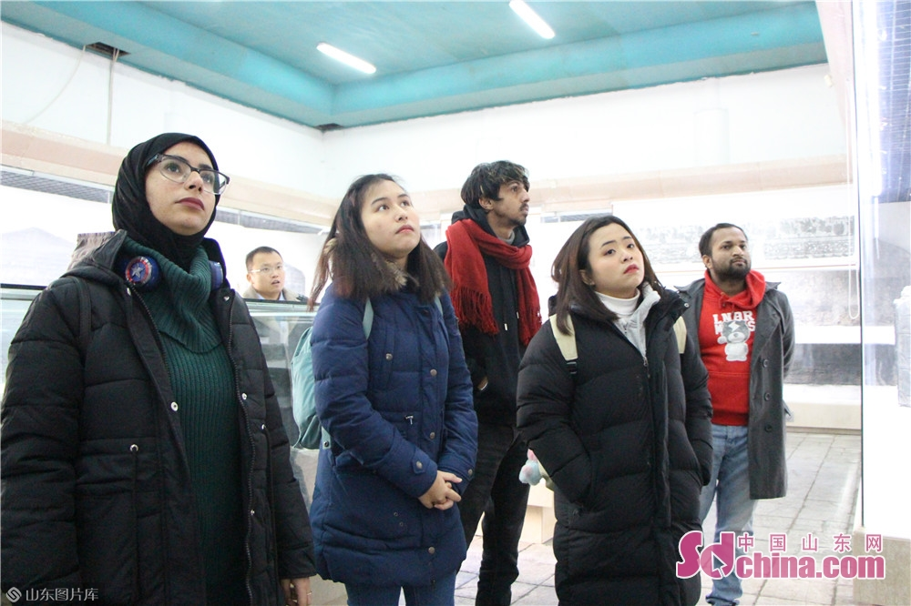 Foreigners visit Wu Family&rsquo;s Ancestral Temple on Dec. 18, 2019 in Jiaxiang County, Jining City. Foreigners from four different countries went to Jiaxiang County, the home land of Zeng Zi, to deeply explore Chinese traditional culture.<br/>
