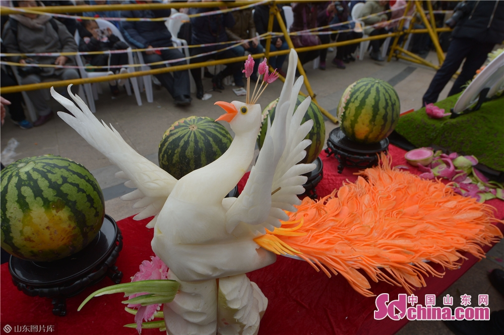 Photo taken on Feb. 13 shows the exquisite food sculpture during the Qingdao Radish &amp; Sweet Dumplings &amp; Tomatoes on Sticks Festival in Qingdao, east China&amp;rsquo;s Shandong Province.<br/>