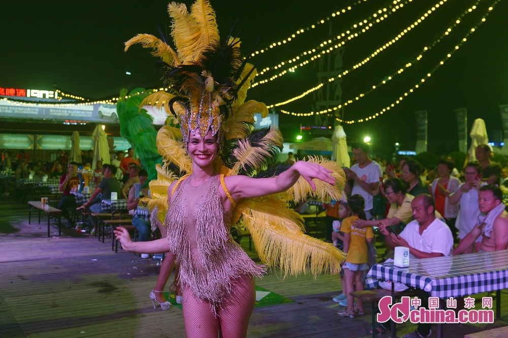 A dancer from abroad perfoms in Laoshan District in Qingdao, east China's Shandong Province, July 26, 2019. The 29th Qingdao International Beer Festival kicked off here on Friday.<br/>
