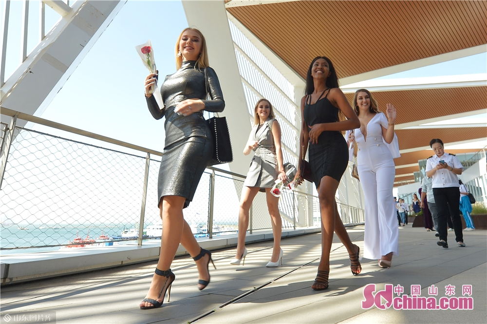 Contestants participate in a trailer shooting at Qingdao Cruise Terminal in Qingdao, east China's Shandong Province, Sept. 22, 2019.<br/>