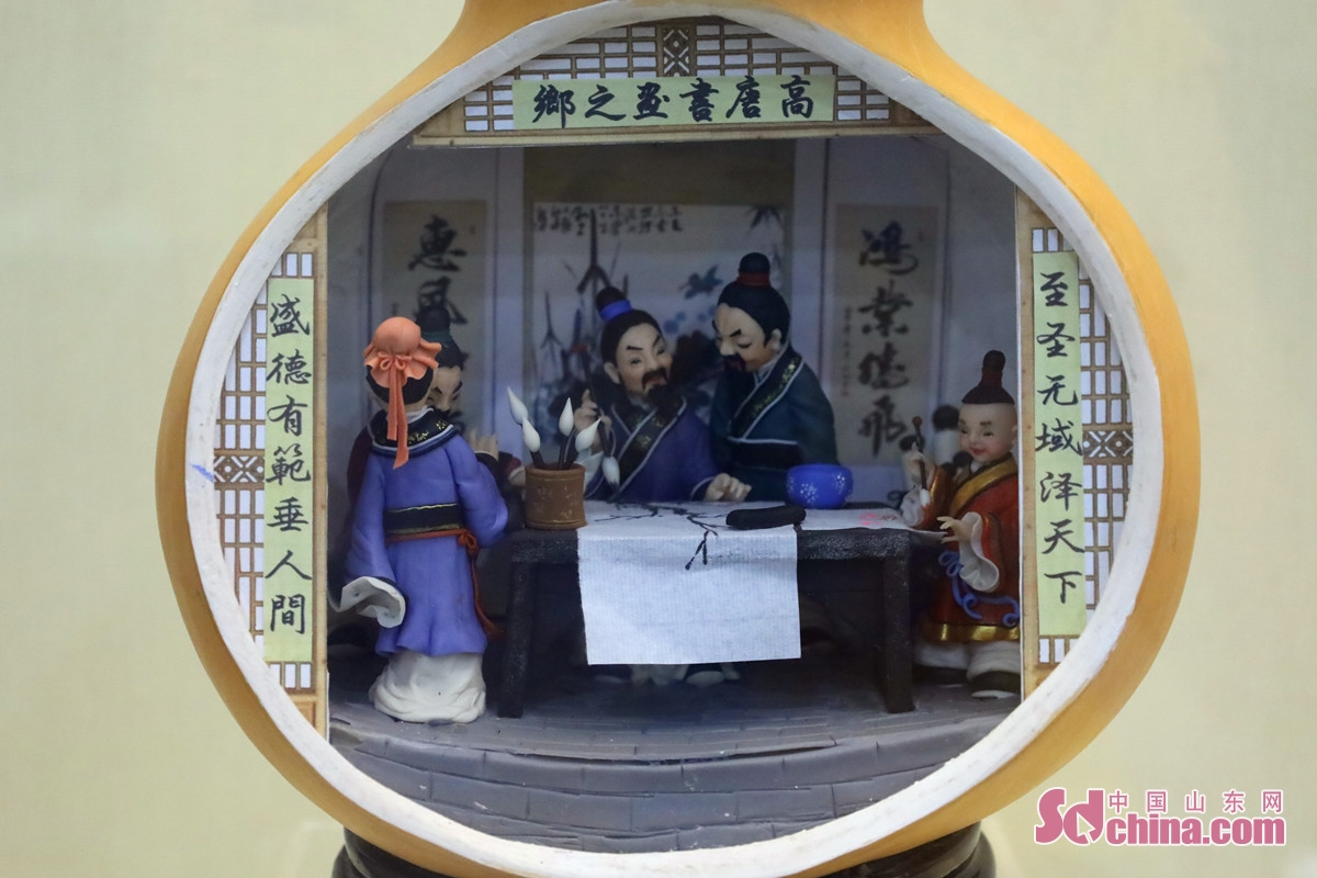 """<br/>Jinan dough sculpture features rich colors, fine techniques and vivid expression. The photo is Qu Yushuang's work """"The Beauty of Calligraphy and Painting"""".<br/>"""