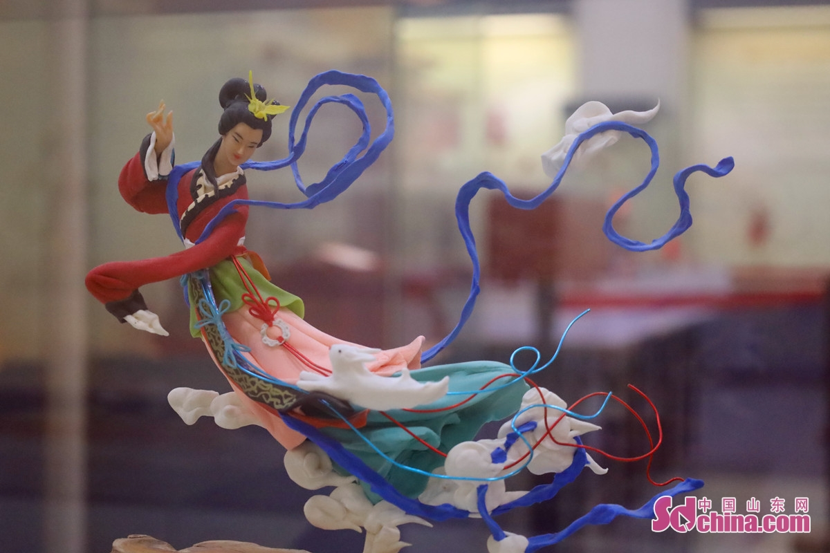 """<br/>Jinan dough sculpture (also known as dough modelling) originated in Heze, Shandong and has a history of more than 100 years since the end of Qing Dynasty. It is now widely distributed in Jinan and surrounding counties, with hundreds of employees. The photo shows Zhang Minyan's work """"Chang'e Flying to the Moon"""", based on the tale of Chang'e, the Chinese goddess of the Moon.<br/>"""