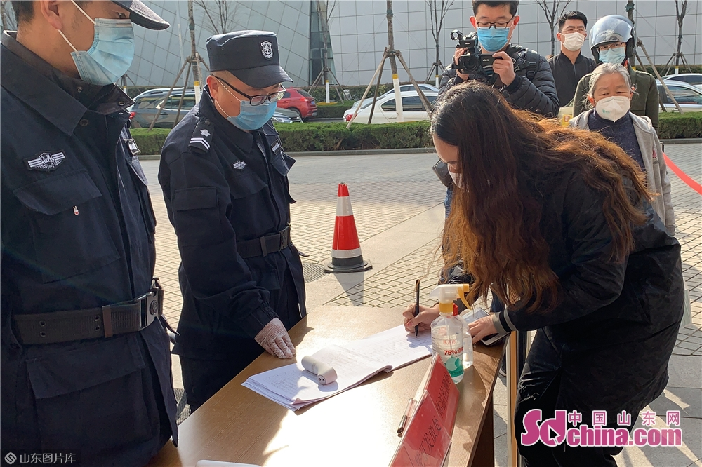 Visitors register their ID information before entering the City Museum in Weifang, east China's Shandong Province on March 25, 2020. Weifang City Library, Wiefang City Museum, Weifang City Art Gallery, Weifang Shihu Garden Museum, and Weifang Kite Museum opened to the public from Wednesday.<br/>