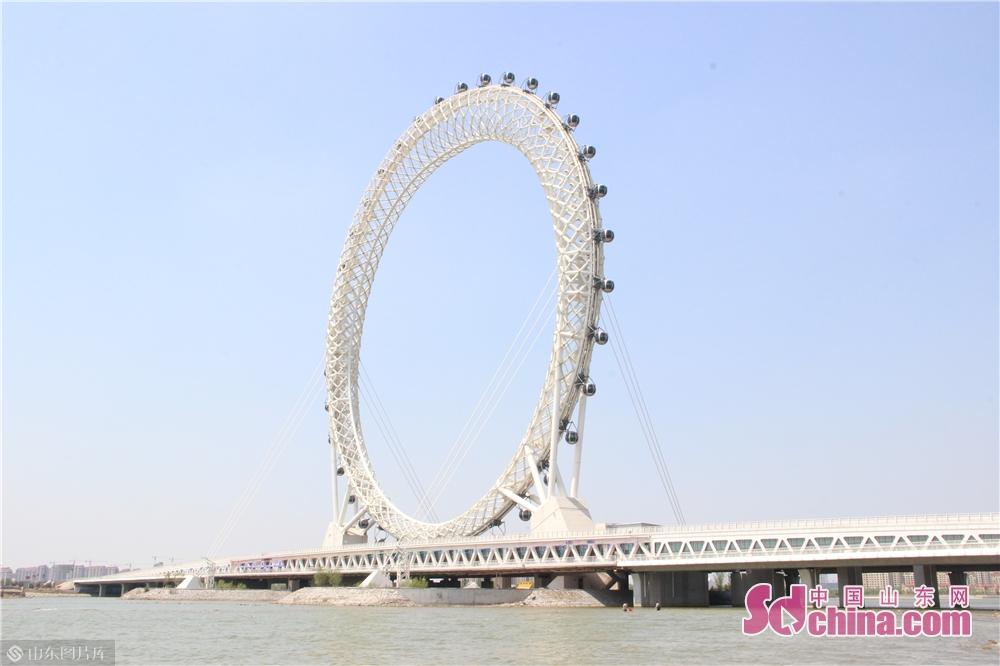 <br/>  渤海之眼摩天轮是白浪河景区标志性项目,创下三项世界之最:世界上最高的无轴式摩天轮、世界上首例编织网格形式的摩天轮,同时也是世界上首次无轴式轮桥合一摩天轮。<br/>