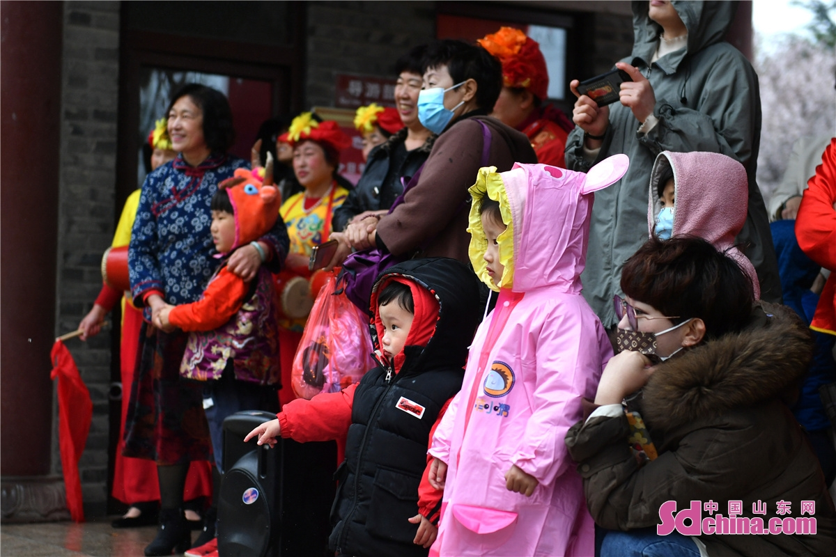 <br/>On April 3, 2021, residents of Hanjia Folk Village in Chengyang District of Qingdao, east China's Shandong Province, celebrate the Qingming Festival with traditional folk custom programs to commemorate fishing progenitor.