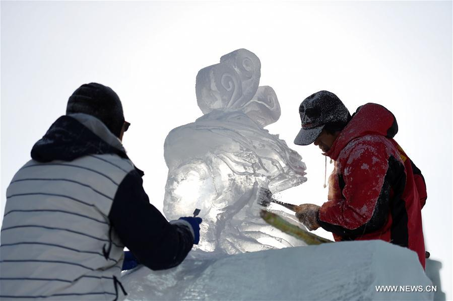 Contestants carve ice sculpture during an international ice sculpture competition in Harbin, capital of northeast China's Heilongjiang Province, Jan. 2, 2018. Fourteen teams from home and abroad participated in the contest. (Xinhua/Wang Jianwei)