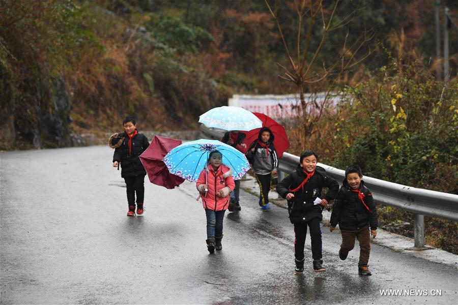 Pupils walk on road after school in Longtang Township of Pengshui County, southwest China's Chongqing City, Jan. 3, 2018. Local authority have been building and maintaining rural roads for the sake of its people and poverty alleviation. (Xinhua/Wang Quanchao)