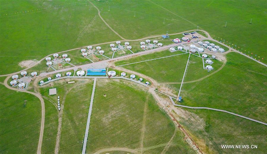 Aerial photo taken on July 21, 2017 shows roads to gers on a ranch near Xilinhot City, north China's Inner Mongolia Autonomous Region. In the past five years, China has seen 1.28 million km of rural roads built or renovated, with 99.24 percent of townships and 98.34 percent of villages connected by asphalt or cement roads. (Xinhua/Lian Zhen)<br/>