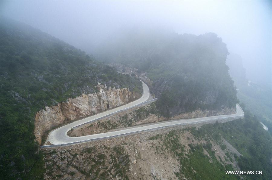 Photo taken on June 14, 2017 shows a road in Yunxi County of central China's Hubei Province. In the past five years, China has seen 1.28 million km of rural roads built or renovated, with 99.24 percent of townships and 98.34 percent of villages connected by asphalt or cement roads. (Xinhua/Xiong Qi)<br/>