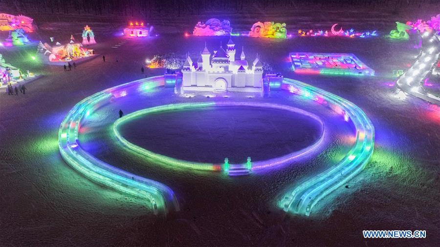 Tourists visit an ice and snow park in Arxan, north China's Inner Mongolia Autonomous Region, Jan. 7, 2018. The ice and snow sculptures here created a fantasy world and attracted a good many tourists. (Xinhua/Liu Lei)
