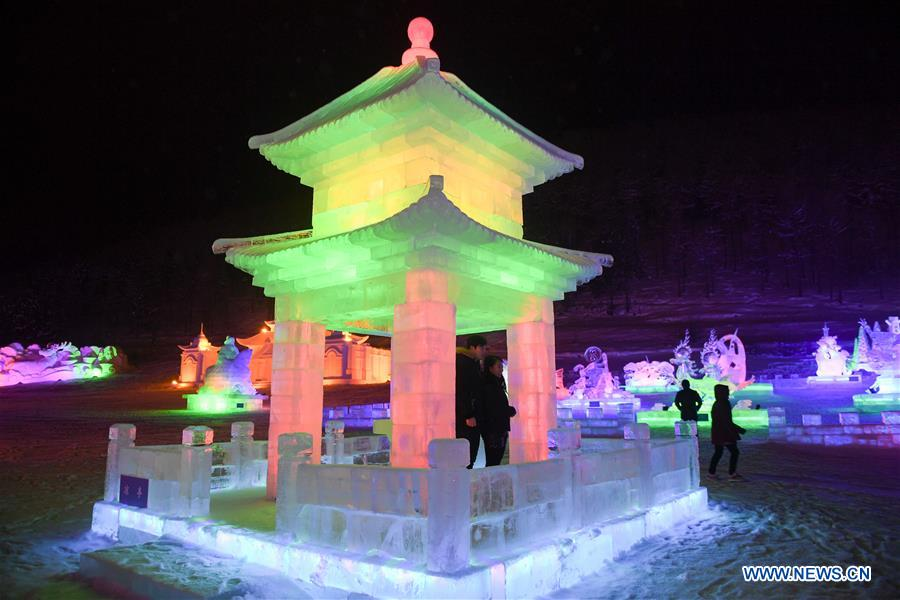 Tourists visit an ice and snow park in Arxan, north China's Inner Mongolia Autonomous Region, Jan. 7, 2018. The ice and snow sculptures here created a fantasy world and attracted a good many tourists. (Xinhua/Liu Lei)<br/>