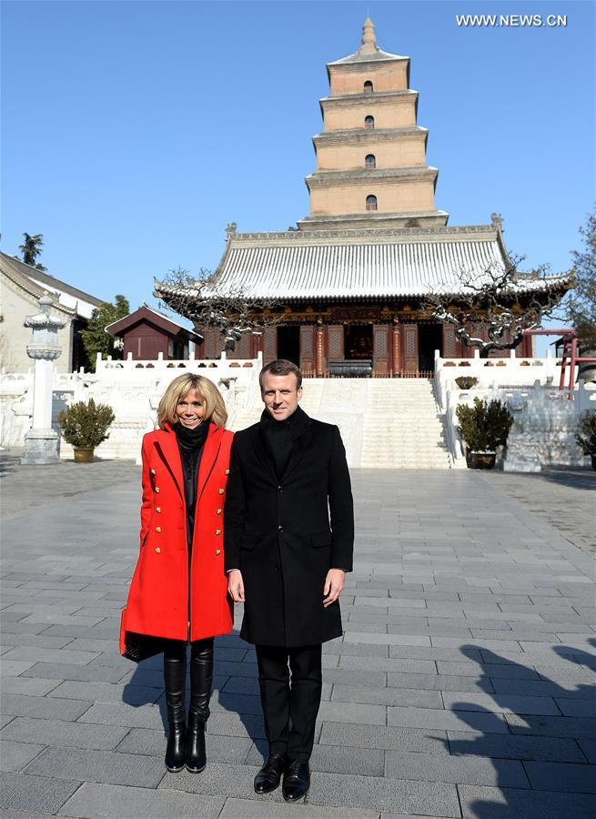 French President Emmanuel Macron and his wife Brigitte Macron pose for a photo at the Dayan Pagoda in Xi'an, capital of northwest China's Shaanxi Province, Jan. 8, 2018. Xi'an is the first stop of Macron's 3-day state visit to China, as invited by Chinese President Xi Jinping. (Xinhua/Liu Xiao)