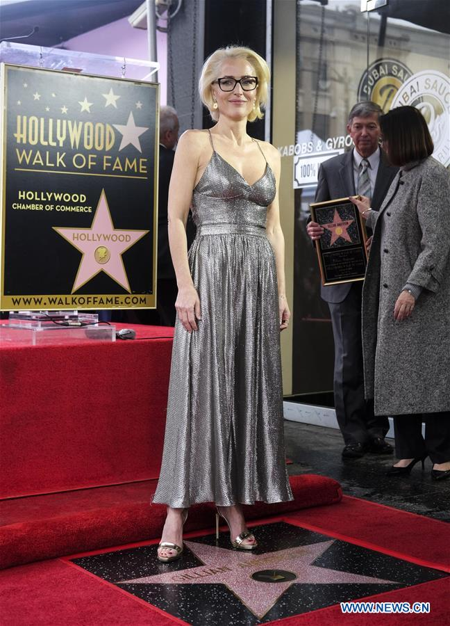 Actress Gillian Anderson attends her Hollywood Walk of Fame ceremony in Los Angeles, the United States, Jan. 8, 2018. Gillian Anderson was honored with a star on the Hollywood Walk of Fame on Monday. (Xinhua/Zhao Hanrong)<br/>