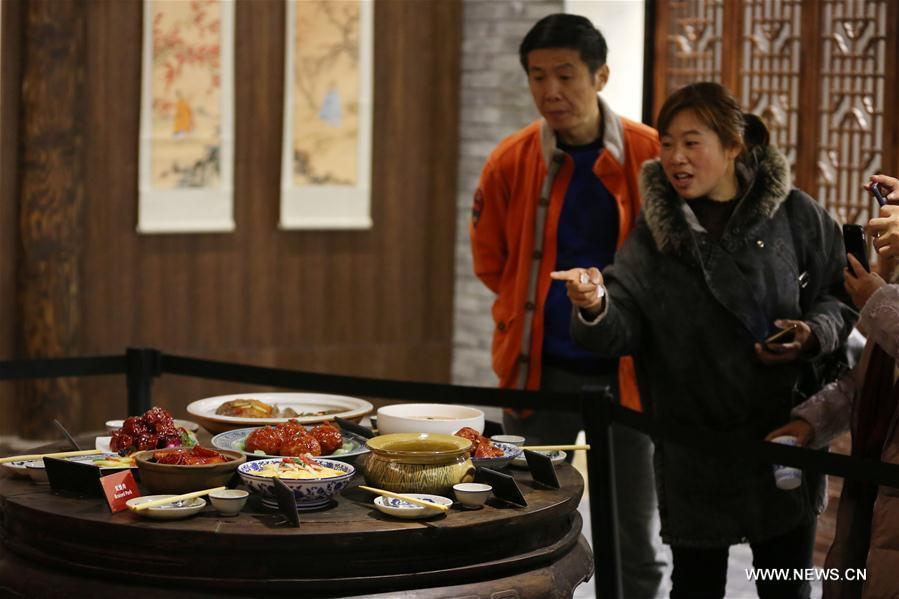 People visit the Anhui Cuisine Museum in Huangshan City, east China's Anhui Province, Jan. 18. 2018. The museum opened to public on Thursday and introduces the history and culture of making Anhui Cuisine. (Xinhua/Shi Yalei)