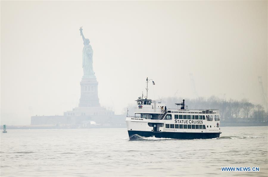 Tourists return with the cruise ship after visiting the Statue of Liberty and Ellis Island in New York, the United States, Jan. 22, 2018. New York City's iconic landmark the Statue of Liberty reopened Monday at the expense of state funds following a brief closure as a result of the U.S. federal government shutdown. According to a news release published on New York State Governor Andrew Cuomo's website, the cost of keeping the Statue of Liberty National Monument and Ellis Island open is 65,000 U.S. dollars per day. (Xinhua/Wang Ying)<br/>