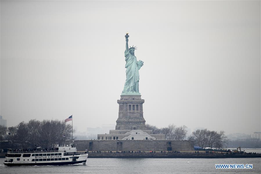 Tourists visit the Statue of Liberty on Liberty Island in New York, the United States, Jan. 22, 2018. New York City's iconic landmark the Statue of Liberty reopened Monday at the expense of state funds following a brief closure as a result of the U.S. federal government shutdown. According to a news release published on New York State Governor Andrew Cuomo's website, the cost of keeping the Statue of Liberty National Monument and Ellis Island open is 65,000 U.S. dollars per day. (Xinhua/Wang Ying)<br/>