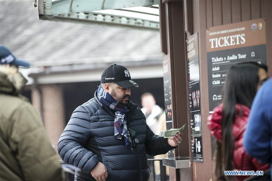 Tourists buy tickets for the cruise to visit the Statue of Liberty and Ellis Island in New York, the United States, Jan. 22, 2018. New York City's iconic landmark the Statue of Liberty reopened Monday at the expense of state funds following a brief closure as a result of the U.S. federal government shutdown. According to a news release published on New York State Governor Andrew Cuomo's website, the cost of keeping the Statue of Liberty National Monument and Ellis Island open is 65,000 U.S. dollars per day. (Xinhua/Wang Ying)