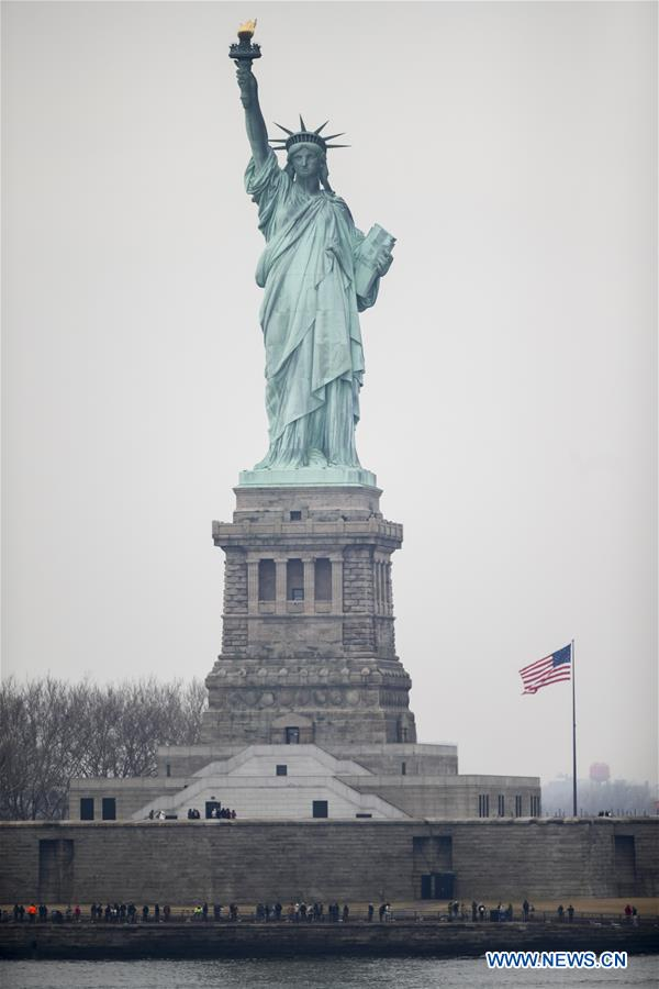 Photo taken on Jan. 22, 2018 shows the Statue of Liberty on Liberty Island in New York, the United States. New York City's iconic landmark the Statue of Liberty reopened Monday at the expense of state funds following a brief closure as a result of the U.S. federal government shutdown. According to a news release published on New York State Governor Andrew Cuomo's website, the cost of keeping the Statue of Liberty National Monument and Ellis Island open is 65,000 U.S. dollars per day. (Xinhua/Wang Ying)<br/>