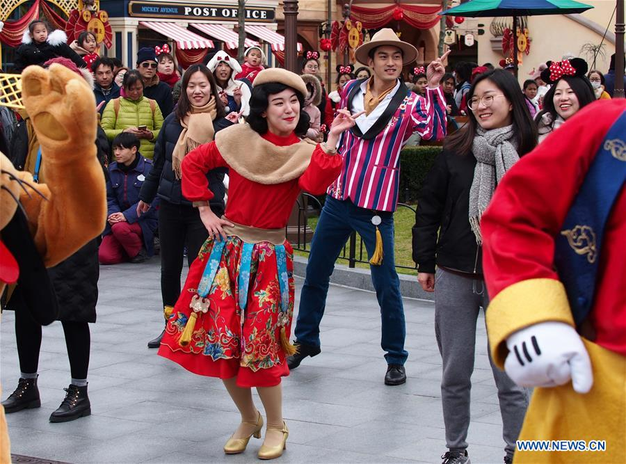 Actors dressed in Disney cartoon character outfits perform old Shanghai swing dance at Shanghai Disney Resort to welcome Chinese Lunar New Year which falls on Feb. 16 this year in Shanghai, east China, Jan. 24, 2018. (Xinhua/Ren Long)<br/>