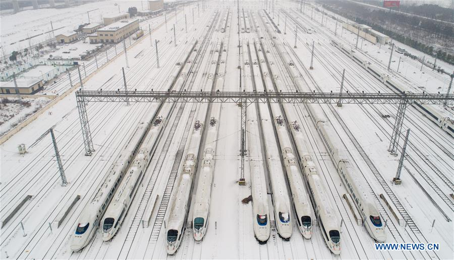Photo taken on Jan. 25, 2018 shows bullet trains for temporary stop at a maintenance station in Hefei, east China's Anhui Province. Snow has disrupted railway transportation in some areas of Anhui since Jan. 24. Some trains influenced by the snowfall stopped at the maintenance station in Hefei for power supply and winter protection. (Xinhua/Guo Chen)<br/>