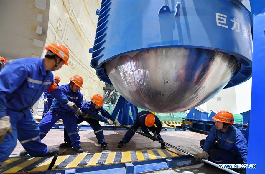 Workers are seen at the installation site of reactor pressure vessel (RPV) of the No.5 unit of China National Nuclear Corporation's Fuqing nuclear power plant in southeast China's Fujian Province, Jan. 28, 2018. It is China's first demonstration nuclear power project using Hualong One technology, a domestically developed third-generation reactor design. (Xinhua/Lin Shanchuan)<br/>