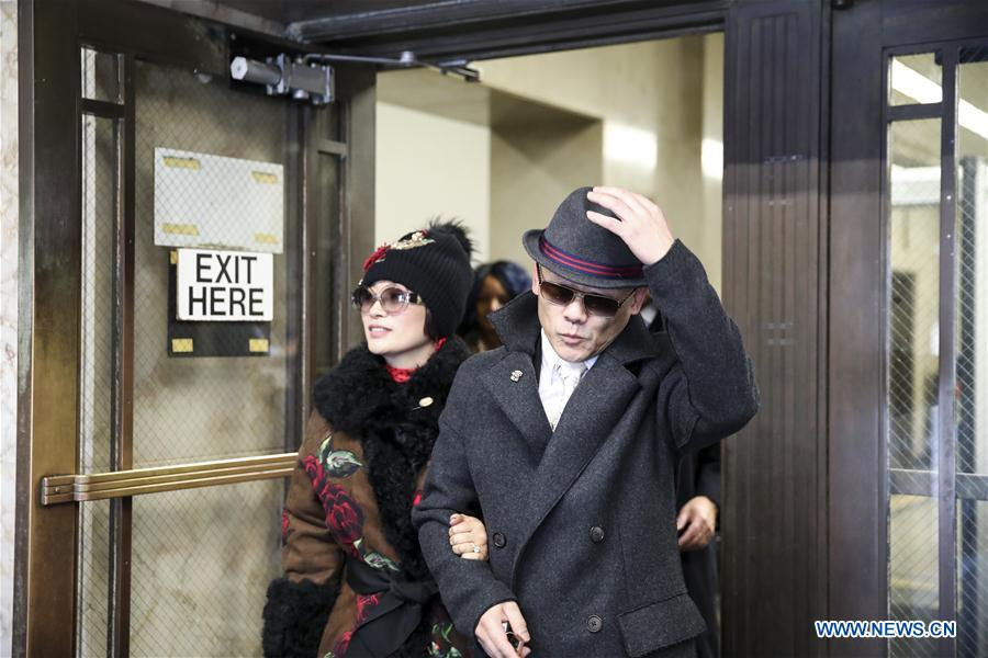 Zhou Libo (R) walks out of Nassau County Court after a court session in Nassau County, New York, the United States, Feb. 1, 2018. Chinese comedian Zhou Libo appeared in a court session with the judge and prosecutor here on Thursday. Zhou is charged with illegal possession of a handgun, possession of a controlled substance identified as crystal methamphetamine and driving while using a cellphone. (Xinhua/Wang Ying)<br/>