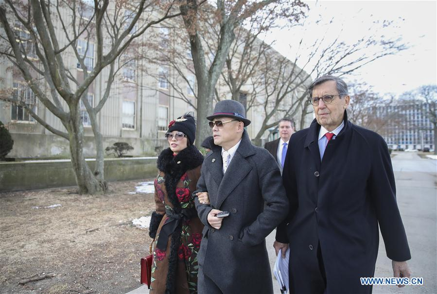 Zhou Libo (C) leaves Nassau County Court after a court session in Nassau County, New York, the United States, Feb. 1, 2018. Chinese comedian Zhou Libo appeared in a court session with the judge and prosecutor here on Thursday. Zhou is charged with illegal possession of a handgun, possession of a controlled substance identified as crystal methamphetamine and driving while using a cellphone. (Xinhua/Wang Ying)<br/>