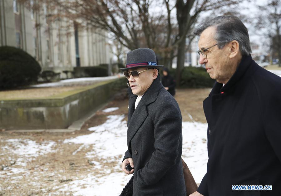 Zhou Libo (L) leaves Nassau County Court after a court session in Nassau County, New York, the United States, Feb. 1, 2018. Chinese comedian Zhou Libo appeared in a court session with the judge and prosecutor here on Thursday. Zhou is charged with illegal possession of a handgun, possession of a controlled substance identified as crystal methamphetamine and driving while using a cellphone. (Xinhua/Wang Ying)<br/>