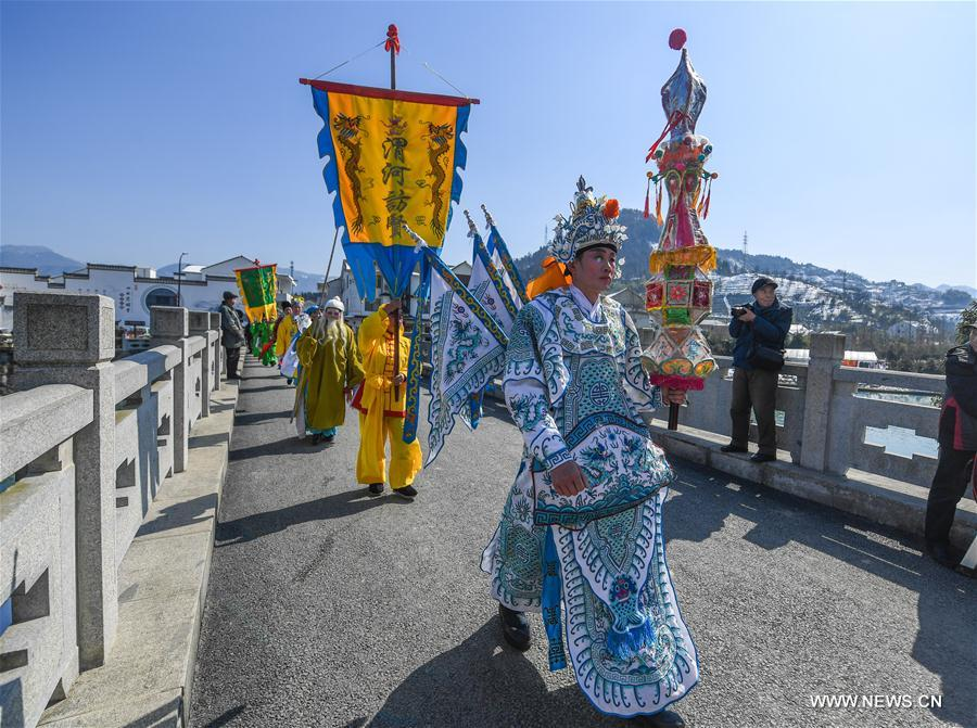 Villagers dressed in traditional costumes take part in a celebrating activity in Tuankou Township of Lin'an District in Hangzhou, east China's Zhejiang Province, Feb. 5, 2018. Various folk activities were held there to celebrate the coming spring festival which falls on Feb. 16. (Xinhua/Xu Yu)<br/>