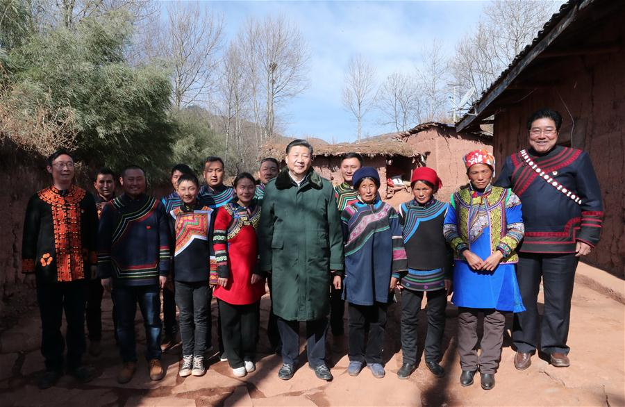 Chinese President Xi Jinping, also general secretary of the Communist Party of China Central Committee, poses for a group photo with villagers at the home of an impoverished family as he visits Sanhe Village of Sanchahe Township in Zhaojue County of Liangshan Yi Autonomous Prefecture, southwest China's Sichuan Province, Feb. 11, 2018. Xi made an inspection tour in Sichuan Province on Feb. 11. (Xinhua/Xie Huanchi)<br/>