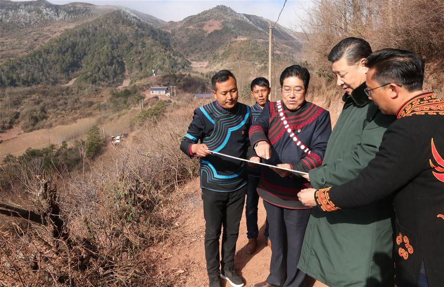 Chinese President Xi Jinping, also general secretary of the Communist Party of China Central Committee, listens to the planning of relocation site for residents from poor areas as he visits Sanhe Village of Sanchahe Township in Zhaojue County of Liangshan Yi Autonomous Prefecture, southwest China's Sichuan Province, Feb. 11, 2018. Xi made an inspection tour in Sichuan Province on Feb. 11. (Xinhua/Ju Peng)<br/>