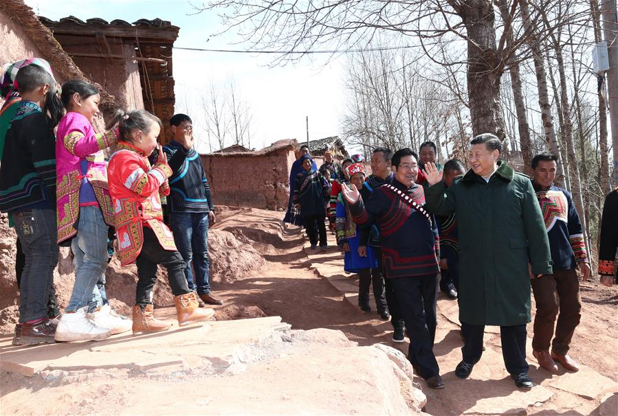 Chinese President Xi Jinping, also general secretary of the Communist Party of China Central Committee, waves to children as he visits Sanhe Village of Sanchahe Township in Zhaojue County of Liangshan Yi Autonomous Prefecture, southwest China's Sichuan Province, Feb. 11, 2018. Xi made an inspection tour in Sichuan Province on Feb. 11. (Xinhua/Ju Peng)<br/>