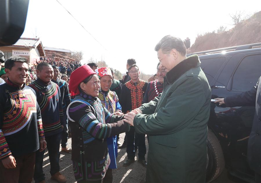 Chinese President Xi Jinping, also general secretary of the Communist Party of China Central Committee, bids farewell to villagers as he visits Sanhe Village of Sanchahe Township in Zhaojue County of Liangshan Yi Autonomous Prefecture, southwest China's Sichuan Province, Feb. 11, 2018. Xi made an inspection tour in Sichuan Province on Feb. 11. (Xinhua/Xie Huanchi)<br/>