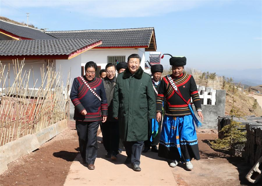 Chinese President Xi Jinping, also general secretary of the Communist Party of China Central Committee, listens to poverty-alleviation work about relocation of residents from poor areas as he visits Huopu Village of Jiefang Township in Zhaojue County of Liangshan Yi Autonomous Prefecture, southwest China's Sichuan Province, Feb. 11, 2018. Xi made an inspection tour in Sichuan Province on Feb. 11. (Xinhua/Ju Peng)<br/>