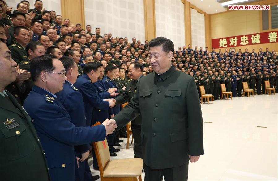 Chinese President Xi Jinping (R, front), also general secretary of the Communist Party of China Central Committee and chairman of the Central Military Commission, meets with senior officers at local military units in Chengdu, southwest China's Sichuan Province, Feb. 12, 2018. (Xinhua/Li Gang)